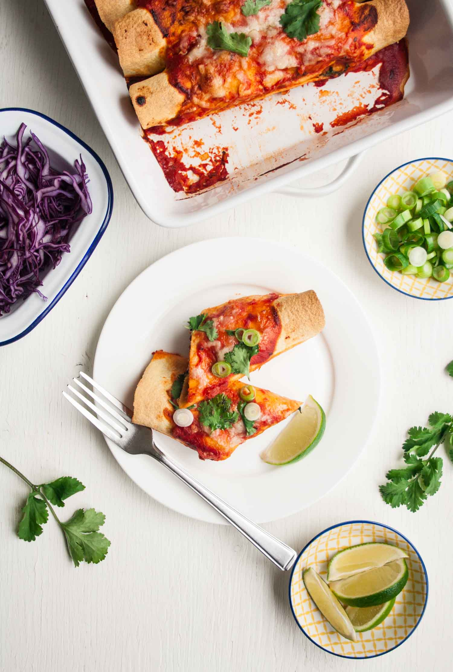 Chicken Enchiladas with Brussels Sprouts and Kale - these hearty enchiladas are full of flavour and feature a simple homemade enchilada sauce and plenty of winter veggies   eatloveeats.com