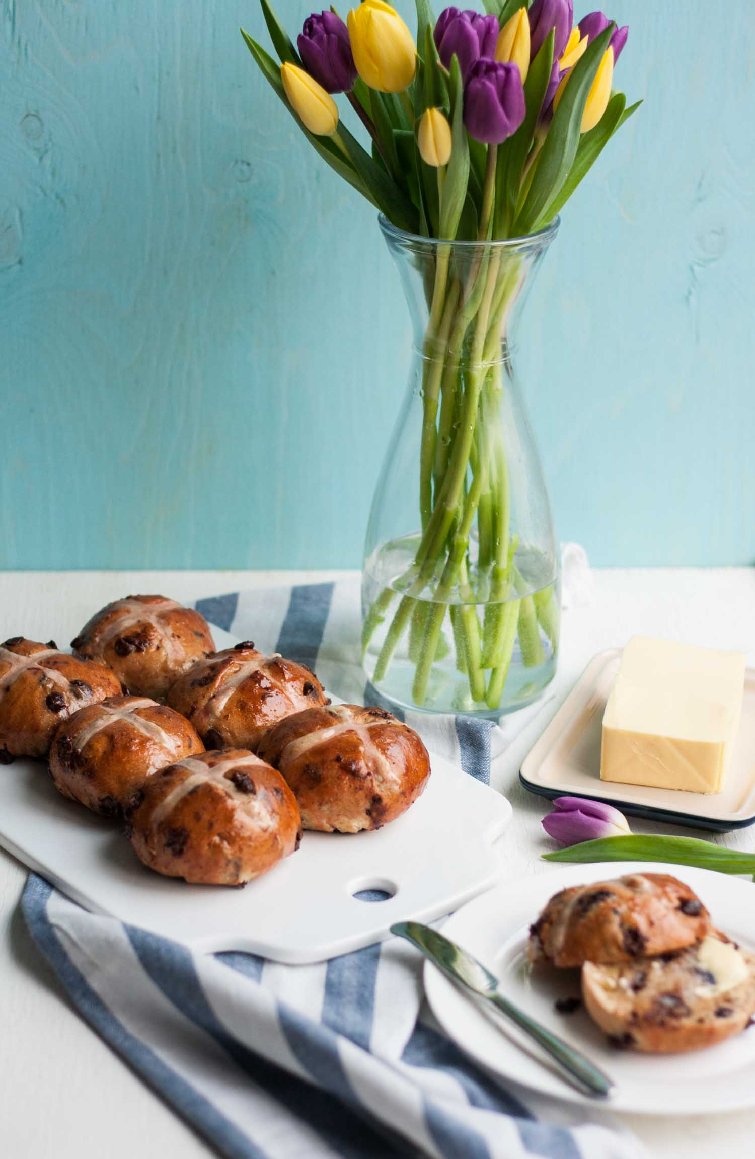 Chocolate Cherry Hot Cross Buns - these richly spiced and pillowy soft hot cross buns are filled with chocolate chips and dried cherries and are the perfect Easter treat!   eatloveeats.com