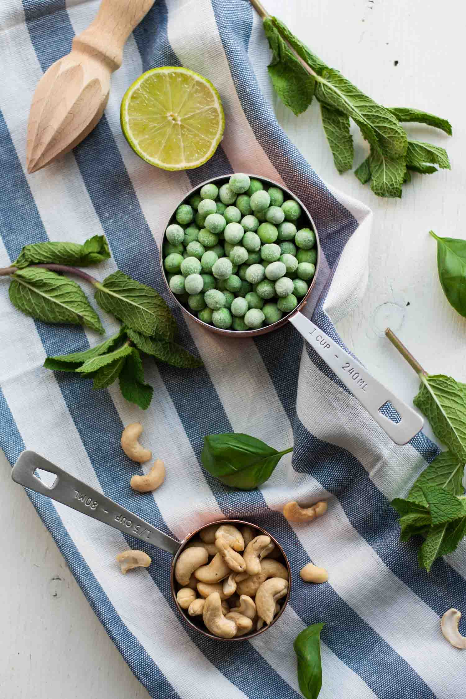 5 Minute Vibrant Spring Sauce - this delicious green sauce recipe has just a few ingredients - peas, cashews, basil, mint, lime - and tastes like you've bottled spring! Ready in 5 minutes flat! | eatloveeats.com