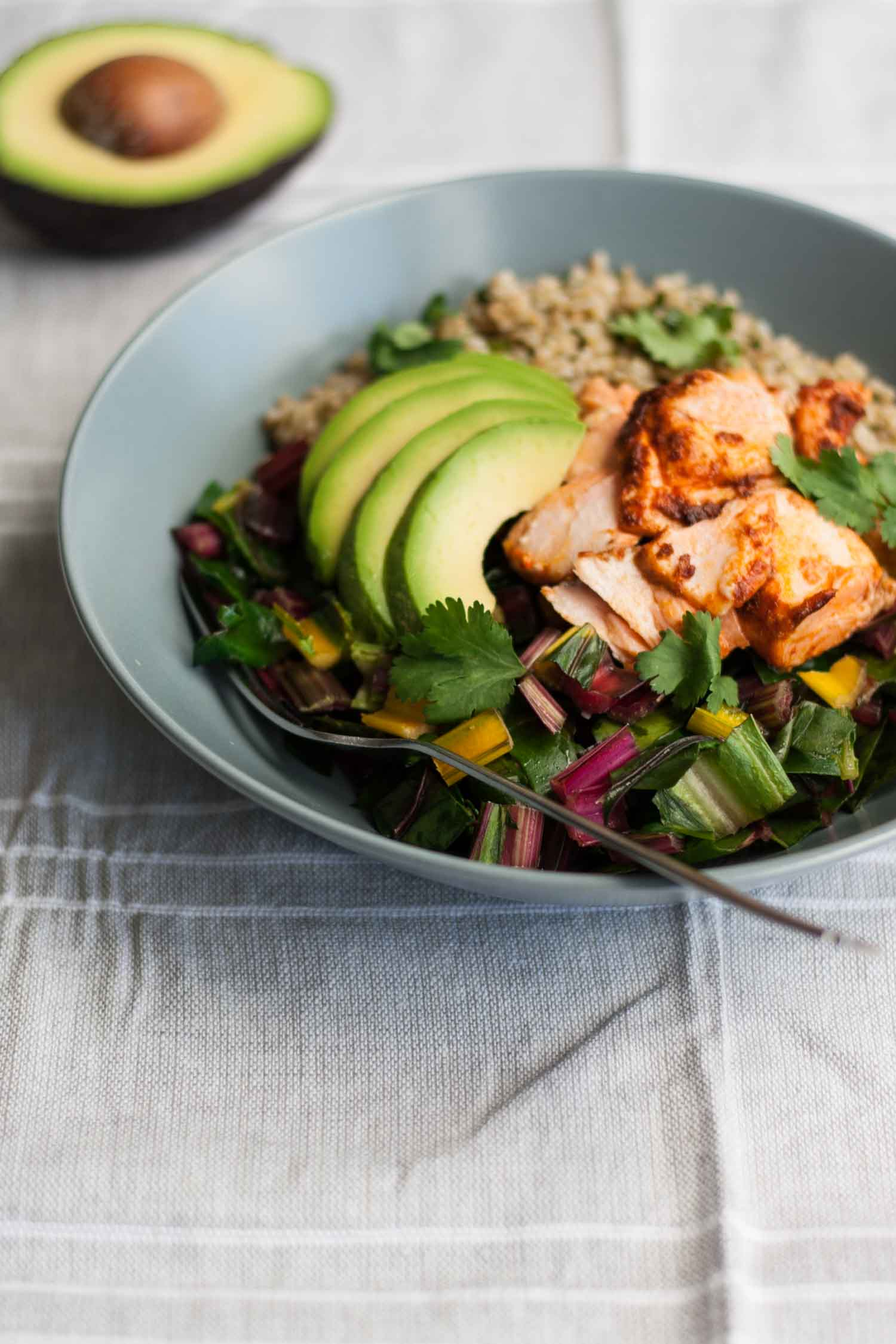 Baked Chipotle Salmon Freekeh Bowls - delicious bowls of hearty freekeh and garlicky greens topped with moist, smoky salmon - a quick, easy and nutritious lunch or dinner recipe!   eatloveeats.com