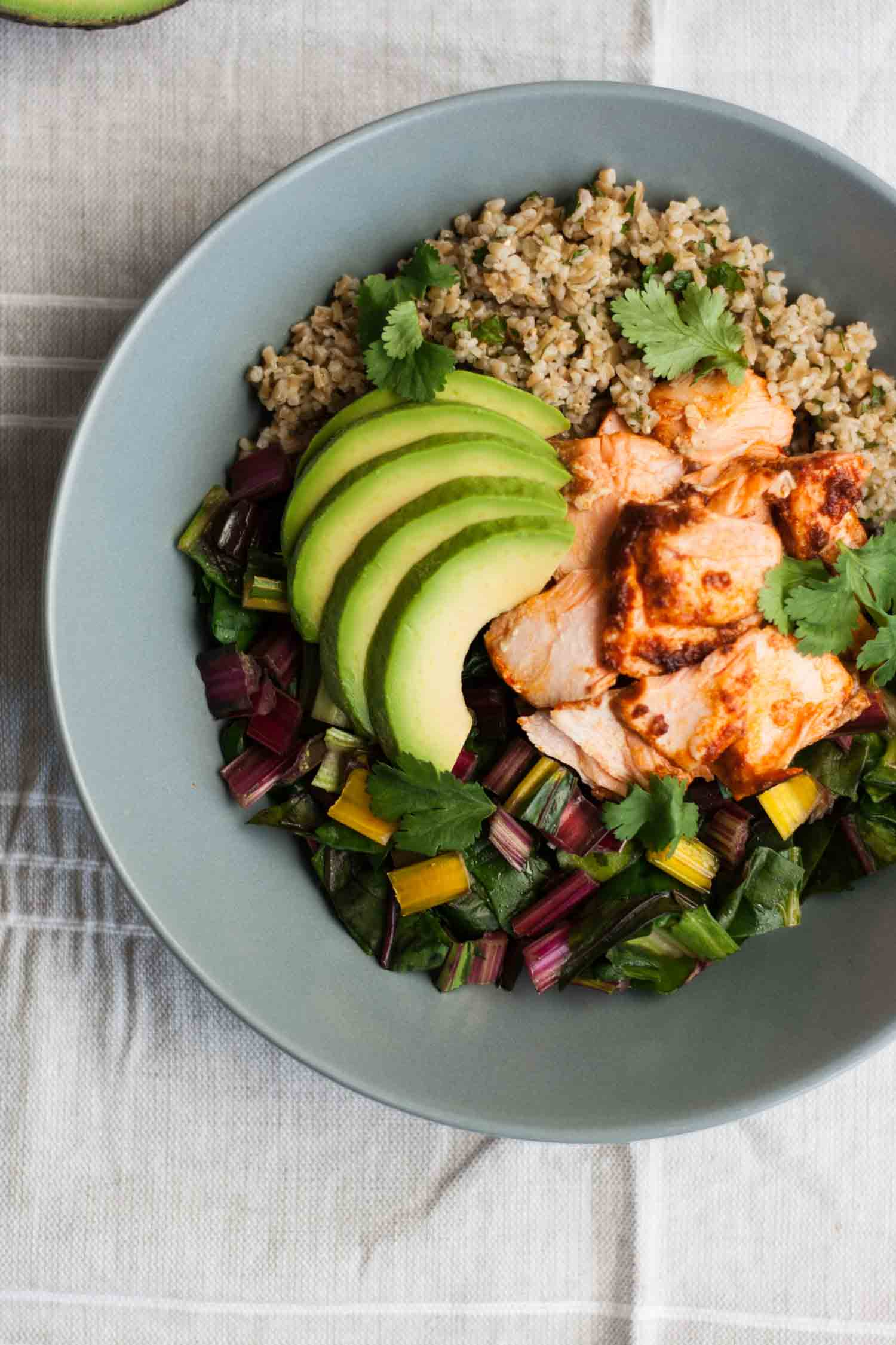 Baked Chipotle Salmon Freekeh Bowls - delicious bowls of hearty freekeh and garlicky greens topped with moist, smoky salmon - a quick, easy and nutritious lunch or dinner recipe! | eatloveeats.com