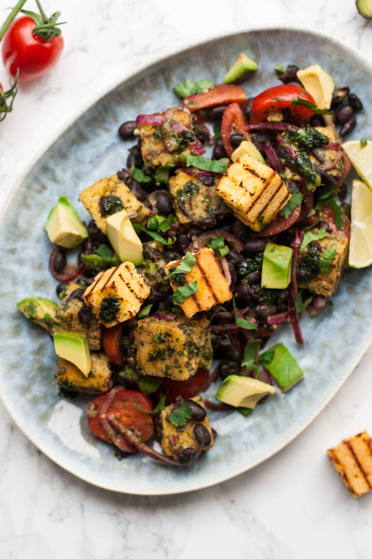 Mexican Panzanella Salad - this flavourful twist on the classic Italian bread salad is filled with black beans, avocado and cornbread and dressed with cilantro oil! | eatloveeats.com