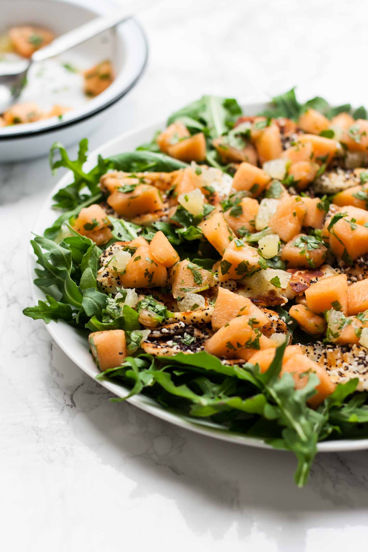 Cantaloupe, Lime and Halloumi Salad - a quick and simple appetizer/lunch recipe that is perfect for summer! | eatloveeats.com