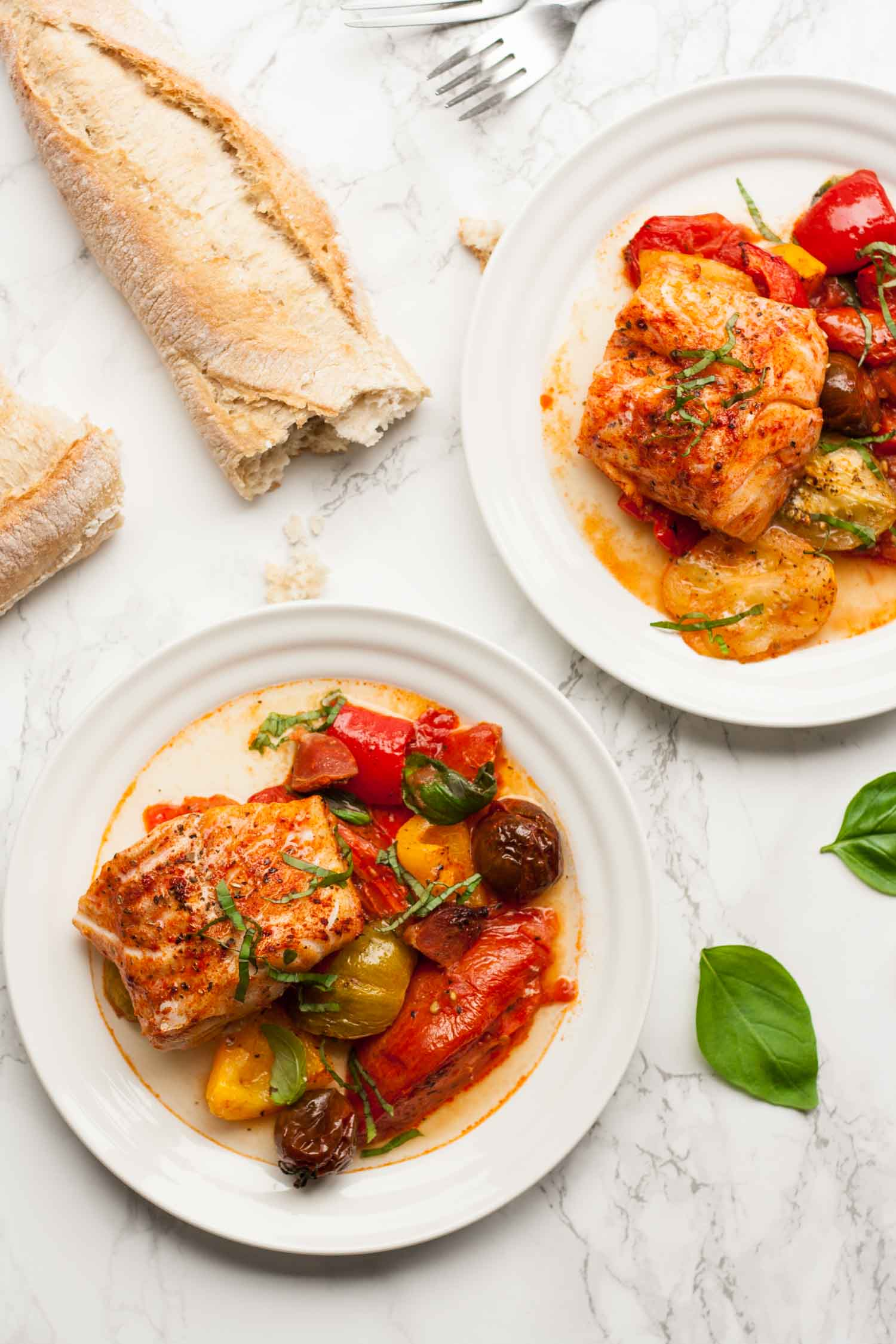 Roasted Heirloom Tomatoes with Cod and Chorizo - this simple summer traybake is full of seasonal produce and tastes amazing! | eatloveeats.com