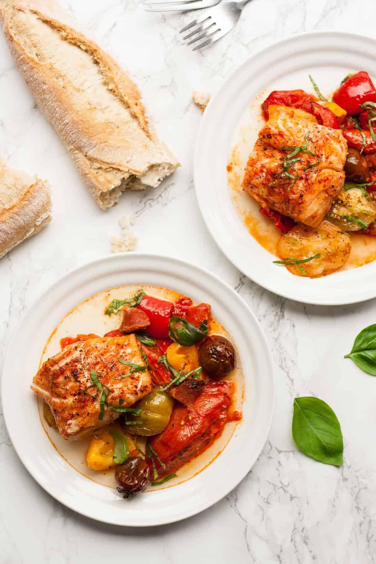Roasted Heirloom Tomatoes with Cod and Chorizo - this simple summer traybake is full of seasonal produce and tastes amazing!   eatloveeats.com