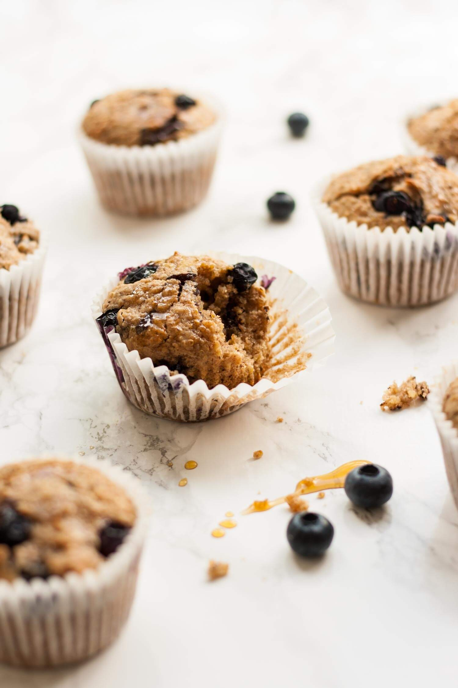 Quinoa Spelt Blueberry Breakfast Muffins - these easy breakfast muffins are full of goodness and taste amazing with a drizzle of warmed maple syrup! | eatloveeats.com