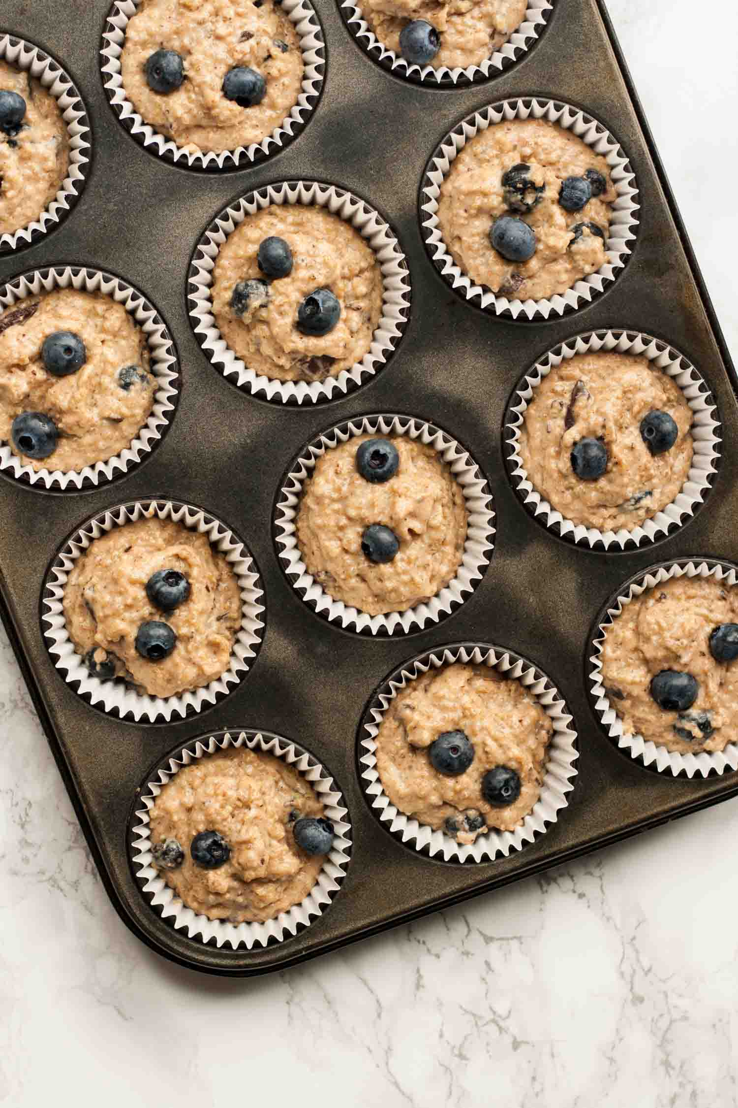 Quinoa Spelt Blueberry Breakfast Muffins - these easy breakfast muffins are full of goodness and taste amazing with a drizzle of warmed maple syrup!   eatloveeats.com