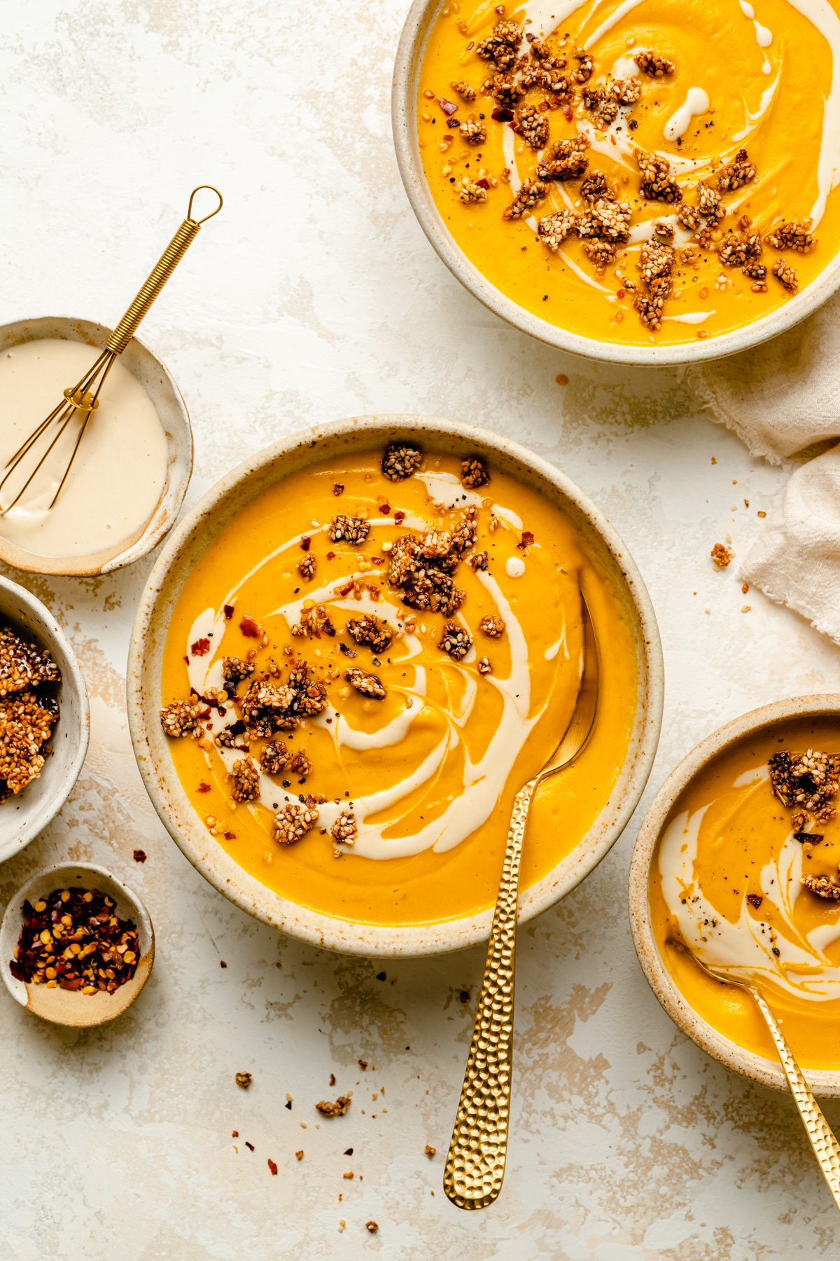 Sweet Potato Tahini Soup - a super simple vegan sweet potato soup, with a tahini swirl and sesame brittle | eatloveeats.com