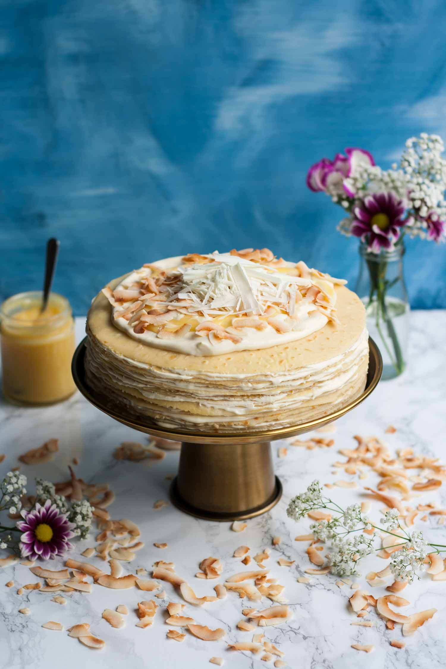 White Chocolate Lemon Curd Crepe Cake - why not try making this gorgeous mille crepe cake as a perfect showstopper centrepiece for Pancake Day or any celebration you can think of! | eatloveeats.com