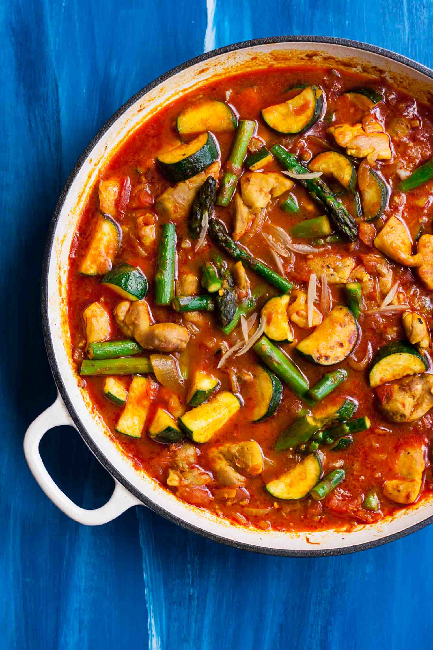 Spring Vegetable Chicken Tagine - this vibrant spiced chicken stew is richly flavoured and packed full of green spring vegetables | eatloveeats.com