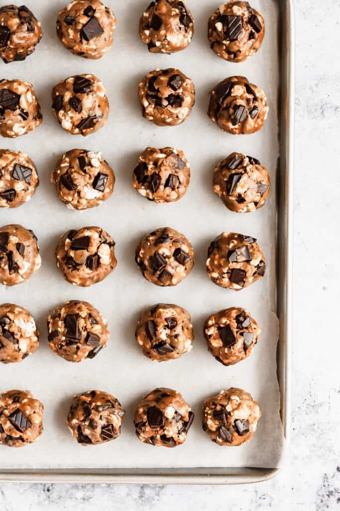 a tray of unbaked balls of cookie dough