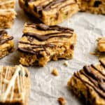 cashew butter granola bars on a piece of crumpled up parchment paper