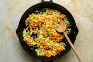 Onion, carrot, celery, garlic and jalapeno sauteing in skillet