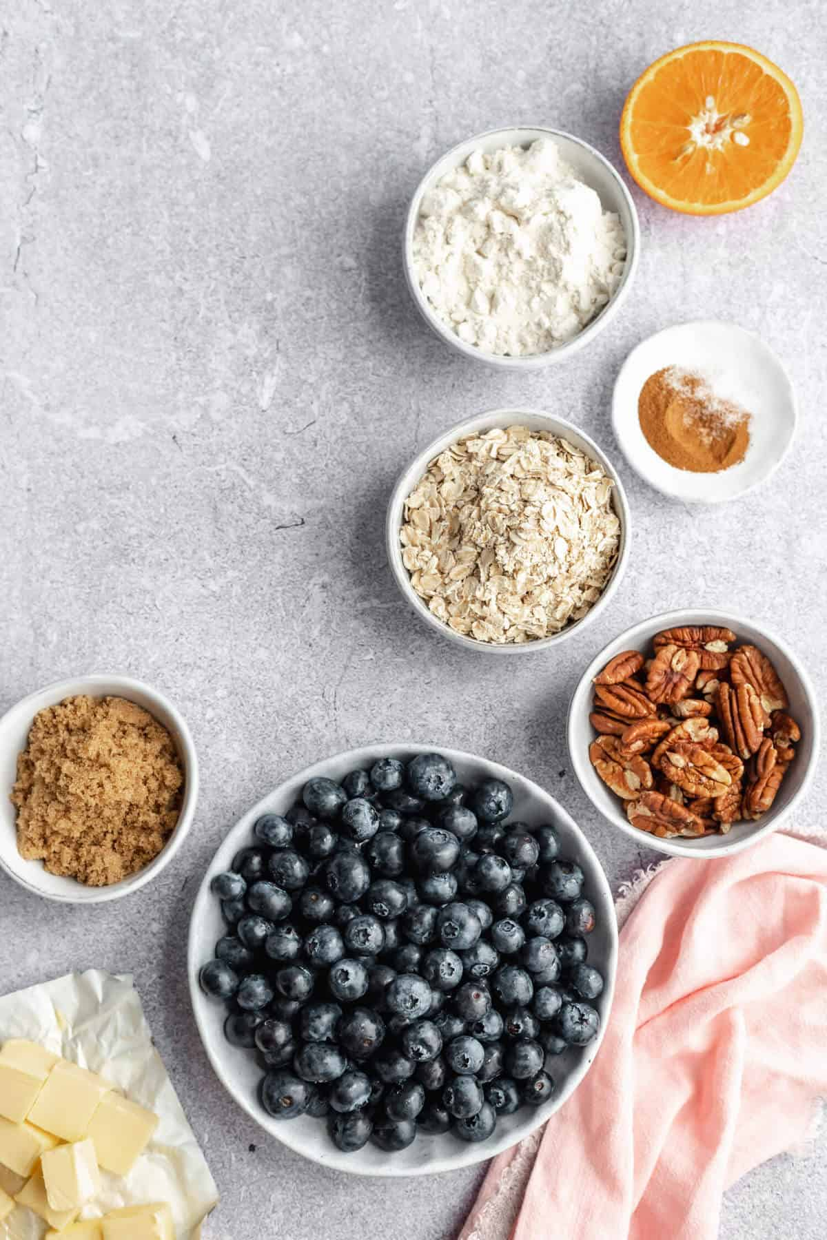 a variety of ingredients in bowls on a concrete surface