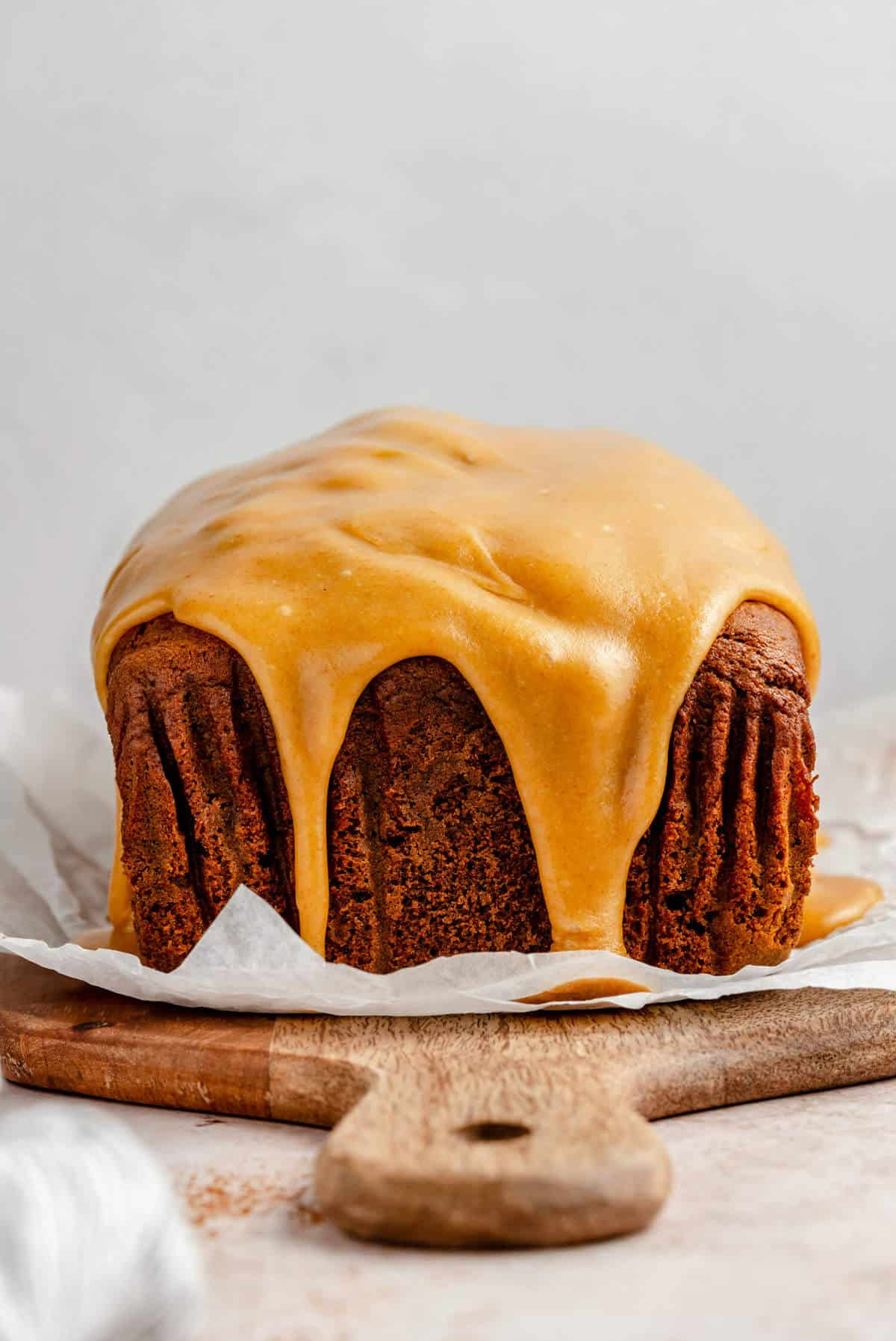 photo of the gingerbread with brown butter caramel glaze dripping over the edge