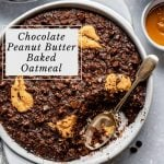 round dish of double chocolate peanut butter baked oatmeal with a scoop taken out and a spoon in the dish