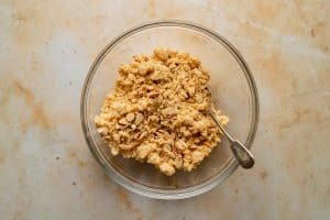 Crumble topping in a bowl with a spoon