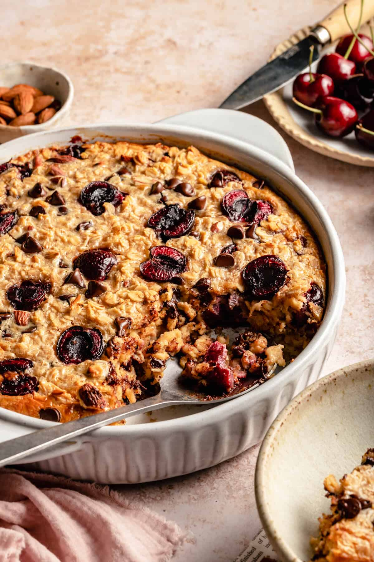close up of the inside of the baked oatmeal with a serving spoon