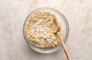 Mixing bowl with dry ingredients and a spoon