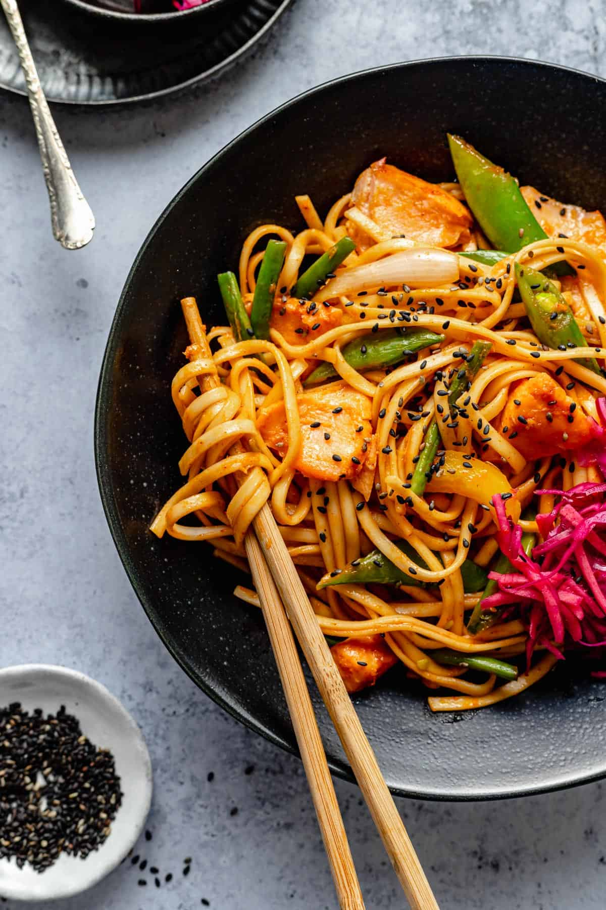 stir fry with chopsticks in a bowl