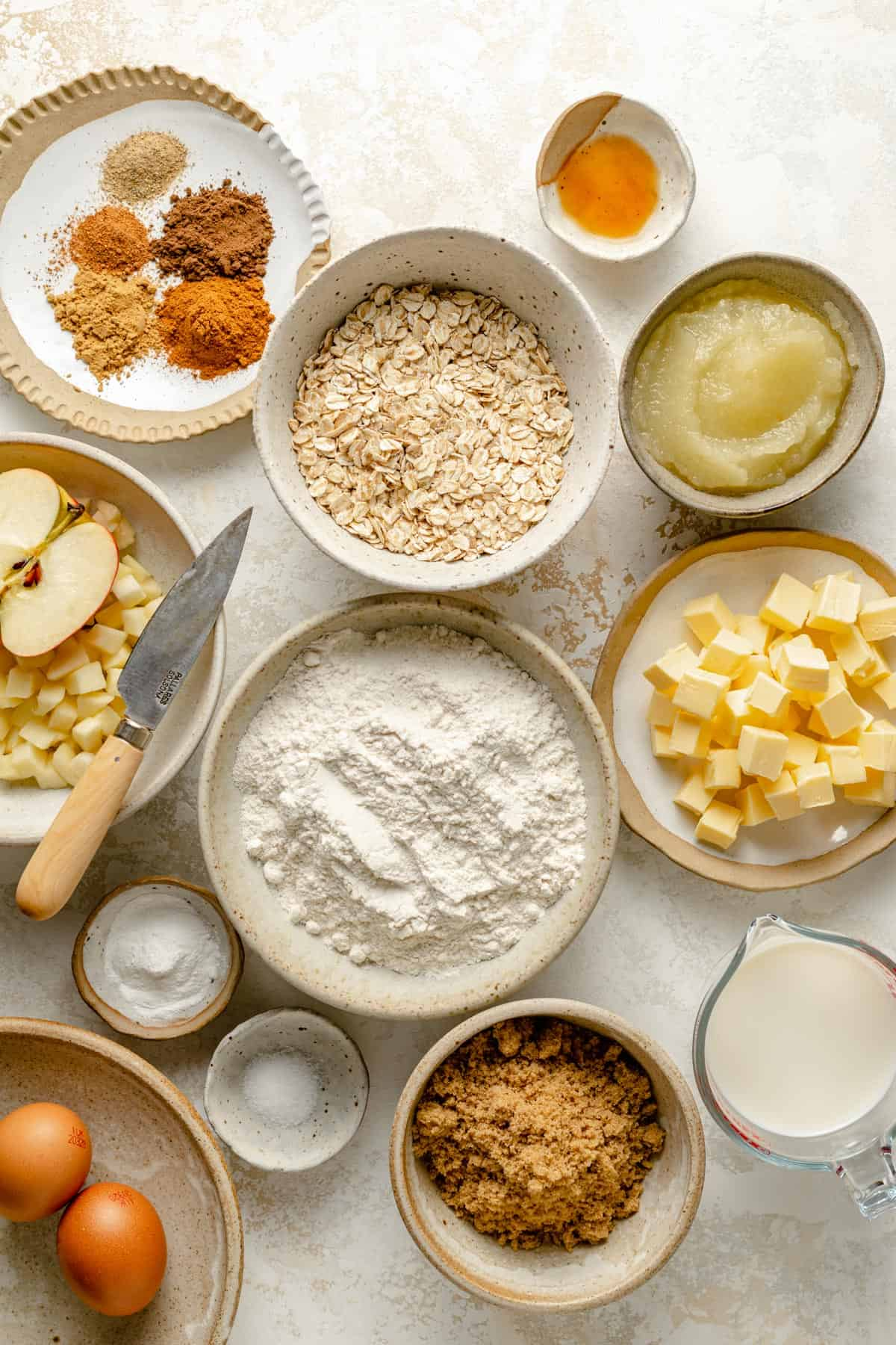 array of ingredients for the muffins in various bowls
