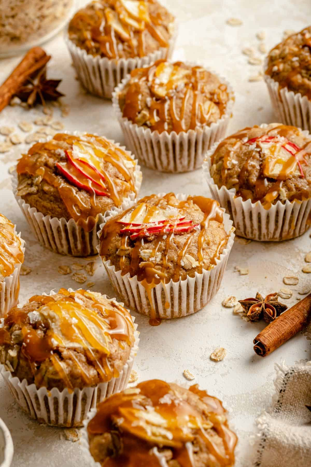 muffins in an array with caramel and spices surrounding