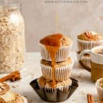 apple oatmeal muffins stacked with a caramel drizzle