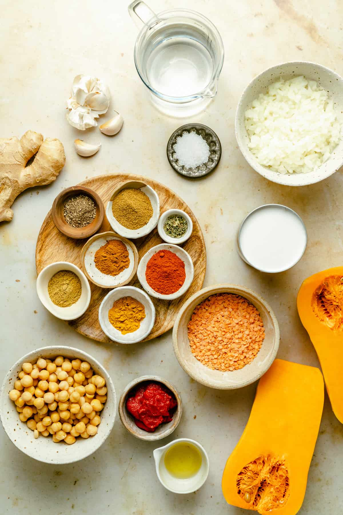 An array of ingredients in bowls needed to make a vegan squash curry.